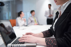 Young business woman on meeting  using laptop computer Stock Image