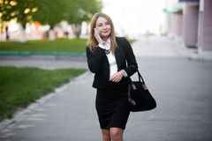 Young business woman on mobile phone Stock Image