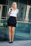 Young business woman with mobile phone smartphone Royalty Free Stock Images