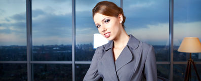 Young  business woman in modern office. Stock Photos