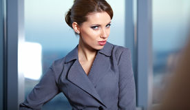 Young  business woman in modern office. Royalty Free Stock Image