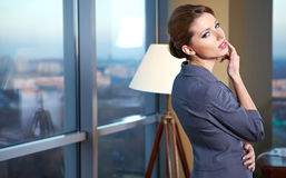 Young  business woman in modern office. Royalty Free Stock Photo