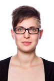 Young business woman with modern short hair, wearing glasses Royalty Free Stock Image