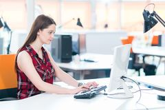 Young business woman at modern startup office royalty free stock images