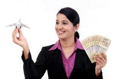 Young business woman with money and toy airplane Royalty Free Stock Photos