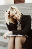 Young business woman with notebook Stock Image