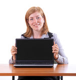 Young business woman with notebook at desk Royalty Free Stock Photography