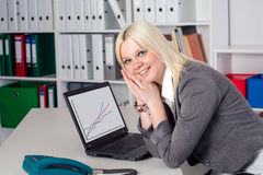 Young business woman in office Stock Photography