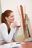Young business woman at office with coffee Royalty Free Stock Photography