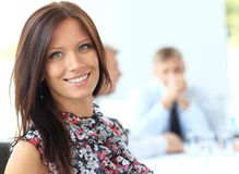 Young business woman in an office. A portrait of a young business woman in an office Stock Image