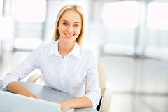 Young business woman in an office Stock Images