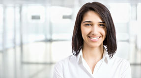 Young business woman in an office Royalty Free Stock Photography