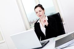 Young business woman in office Royalty Free Stock Image