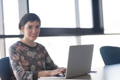Young business woman at office working on laptop with team on me Royalty Free Stock Image