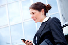 Young business woman outside with mobile phone Stock Image