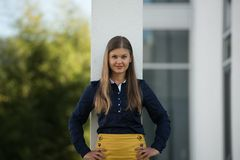 young business woman outside smiles stock photography