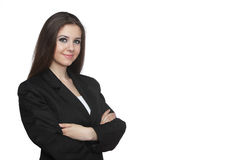Young business woman over white. Young business woman looking at the camera over white Royalty Free Stock Image