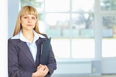 Young business woman with papers Royalty Free Stock Photography