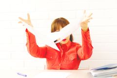 Young business woman with papers flying up stock images