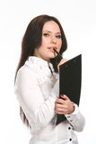 Young business woman with a pen Royalty Free Stock Photos