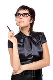 Young business woman with a pen. Isolated young attractive puzzled student, secretary or business woman with a pen Stock Photos