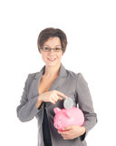 Young business woman with piggy bank Royalty Free Stock Photos