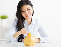Young business woman with  piggybank. Young asian business woman with  piggybank Stock Photo
