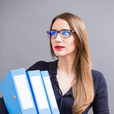 Young business woman with pile of ring binder Stock Images