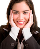Young Business Woman Pleasantly Surprised. A young business woman is holding her face after being pleasantly surprised royalty free stock image