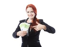 Young business woman point to a lot of euro bank notes Royalty Free Stock Photography