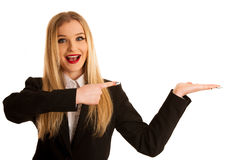 Young business woman pointing in copy space as advertisement for Royalty Free Stock Photography