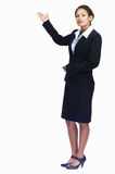 Young business woman pointing at copyspace Stock Photo
