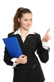 A young  business woman pointing at copyspace. Young woman in business attire holding a planner/daytimer. Isolated on white Stock Photography