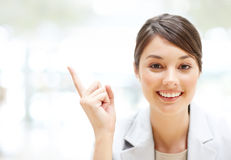 Young business woman pointing at copyspace Stock Photos