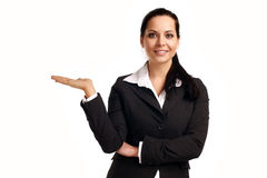Young business woman pointing at copyspace. A young beautiful business woman pointing at copyspace Royalty Free Stock Image