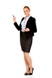 Young business woman pointing for copyspace or board Royalty Free Stock Image