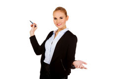 Young business woman pointing for copyspace or board.  Royalty Free Stock Photo
