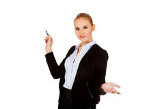 Young business woman pointing for copyspace or board.  Stock Image