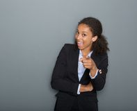 Young business woman pointing finger at you. Close up portrait of a happy young business woman pointing finger at you Royalty Free Stock Images