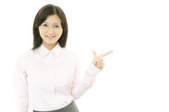 Young business woman pointing stock photography