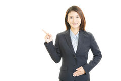 Young business woman pointing Stock Photo