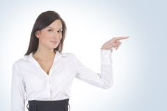 A young business woman is pointing at something Stock Images
