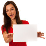 Young business woman pointing to copy space, showing a product i Royalty Free Stock Photography