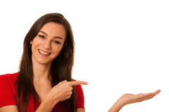 Young business woman pointing to copy space, showing a product i Stock Photography