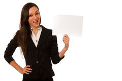 Young business woman pointing to copy space, showing a product i Royalty Free Stock Photos