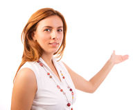 Young business woman pointing to open space Royalty Free Stock Photo