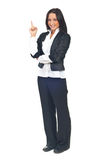 Young business woman pointing up Stock Images