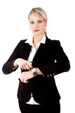 Young business woman points at her watch royalty free stock photo