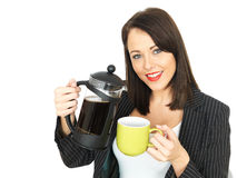 Young Business Woman Pouring Out Coffee Stock Photo