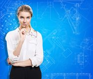 Young business woman present blueprint. Royalty Free Stock Photo